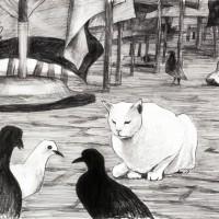 青いテーブルクロスと白い猫