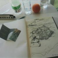 ホテルのフロント前の置いているメッセージ帳に私も絵を描き入れる。部屋で1人で描いた時の至福のひととき。